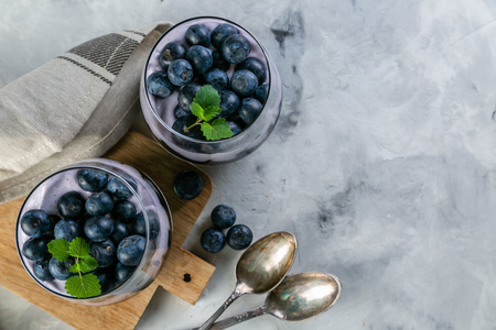 Detox activated charcoal chia pudding breakfast with blueberries Stock fotó