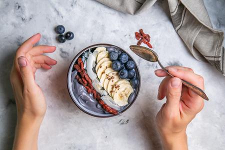 Female eats detox activated charcoal yogurt bowl