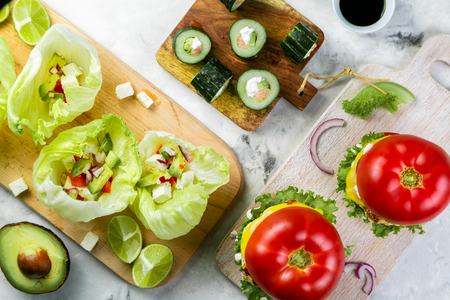 Selection of low carb meal options - burger, taco, sushi Stock Photo