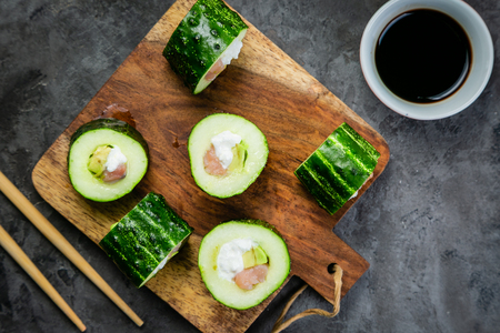 Low carb sushi alternative - cucumber sushi with salmon and avocado