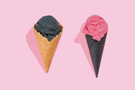 Creative layout - ice cream cones with black ice cream, top view Stock Photo