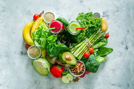 Alkaline diet concept - heart shaped fresh foods on rustic background Banque d'images - 104852166