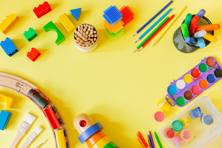 Day care concept - art supplies and toys on bright background, top view Stok Fotoğraf - 105039567