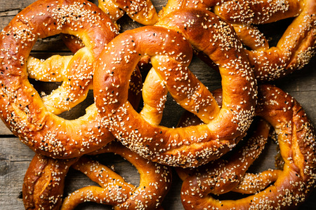 Oktoberfest concept - pretzels on rustic wood background, top view Stock Photo - 105425371
