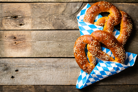 Oktoberfest concept - pretzels on rustic wooden background Banco de Imagens