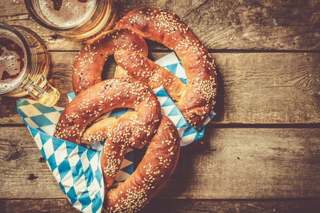 Oktoberfest concept - pretzels and beer on rustic wood background, top view 版權商用圖片