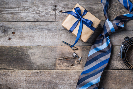 Fathers day concept - present, tie on rustic wood background Imagens