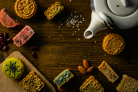 Mid Autumn Festival concept - yuebing monncakes on rustic background, top view