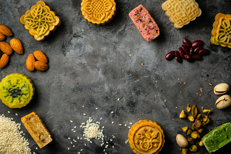 Mid Autumn Festival concept - yuebing monncakes on rustic background