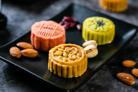 Mid Autumn Festival concept - mooncakes on rustic background