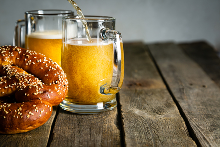 Oktoberfest concept - pretzels and beer on rustic wood background Stock Photo