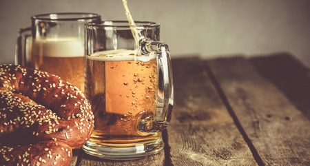 Oktoberfest concept - pretzels and beer on rustic wood background, copyspace for text Stock Photo
