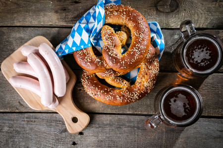 Oktoberfest concept - traditional food and beer on rustic background, copy space