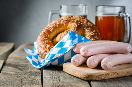 Oktoberfest concept - traditional food and beer on rustic background
