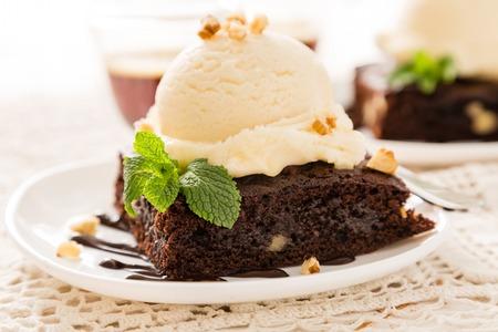 Chocolate brownie with vanilla ice cream, nuts and mint Archivio Fotografico - 107410483