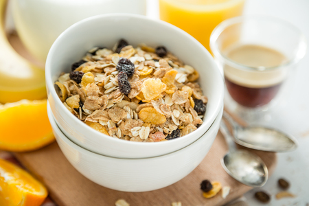 Breakfast - muesli and fruits on white background 스톡 콘텐츠