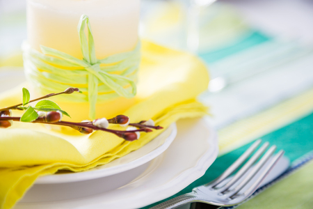 Spring easter table setting with silverware and napkins, copy space