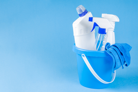 Cleaning supplies - bottles, sprays sponge on bright pastel background 写真素材
