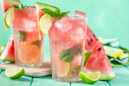 Watermelon lemonade with lime and mint, wood background Stok Fotoğraf