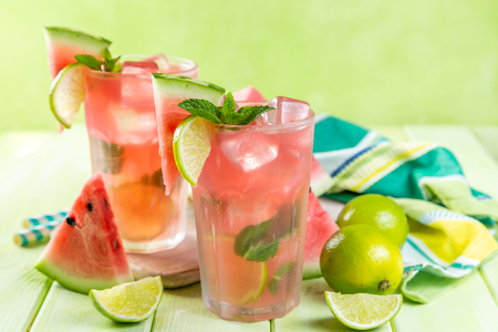 Watermelon lemonade with lime and mint, wood background, copy space Stock Photo