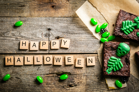 Halloween style party sweet - brownie with green skeleton and bones Stock Photo