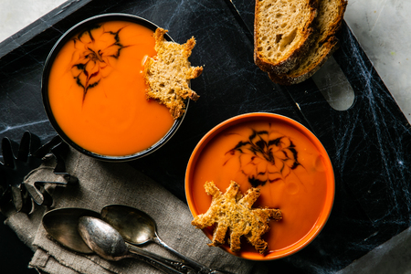 Halloween style pumpkin soup - with spider shaped toast Stock Photo