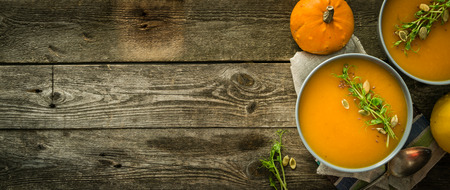 Pumpkin soup with pea micro green and seeds Stock Photo