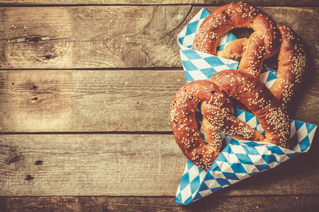 Oktoberfest concept - pretzels on rustic wood background Stock Photo - 109038539
