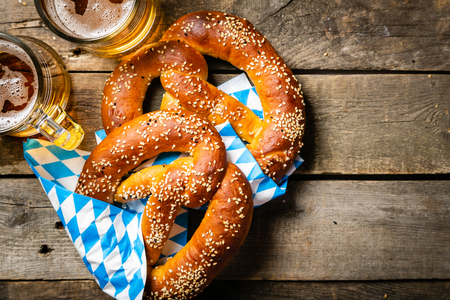 Oktoberfest concept - pretzels and beer on rustic wood background Banco de Imagens