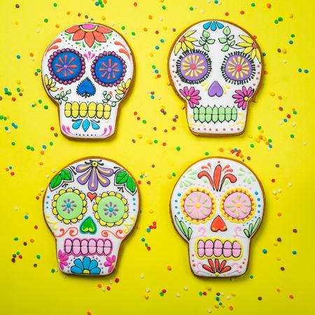 Dia de los muertos concept - skull shaped cookies with colorful decorations