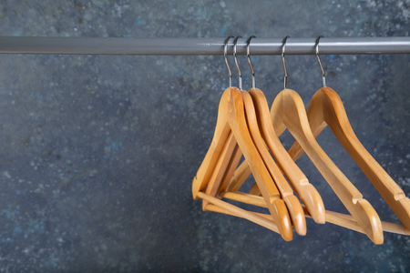 Wood empty hangers on rack with rustick background
