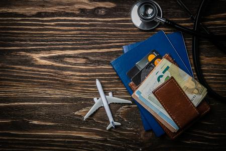 Medical tourism concept - passports, stethoscope, airplane, money Stock Photo