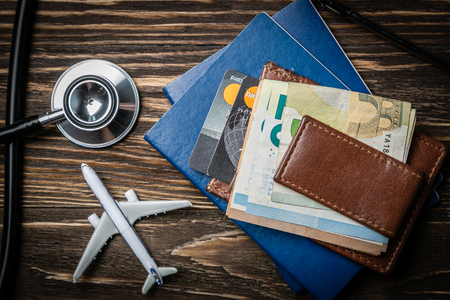 Medical tourism concept - passports, stethoscope, airplane, money 版權商用圖片