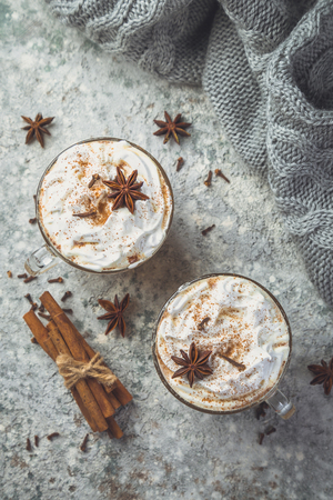 Chai latte and ingredients on concrete background