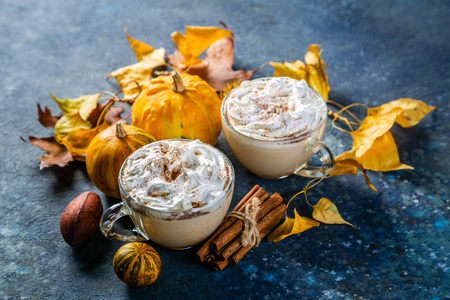 Pumpkin spice latte in glass cups on concrete blue background, copy space Stock Photo
