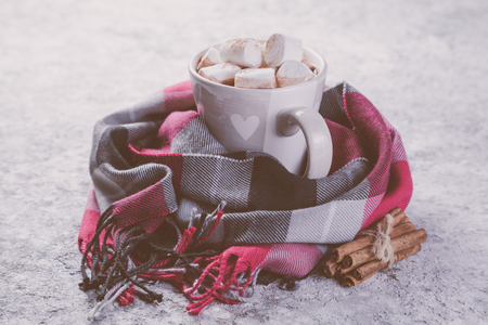 Hot chocolate with marshmallow and scarf