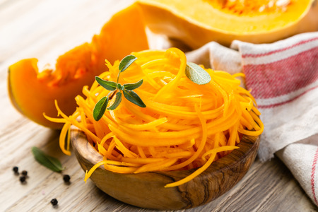 Butternut squash vegetarian noodles on rustic background