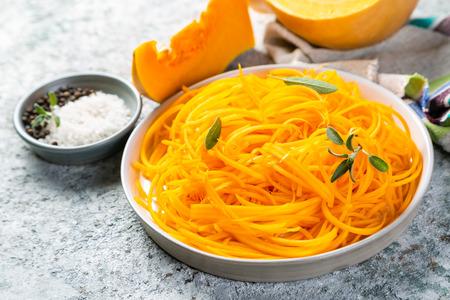 Butternut squash vegetarian noodles on rustic background