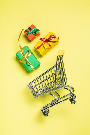 Online shopping concept - trolley cart full of presents 版權商用圖片