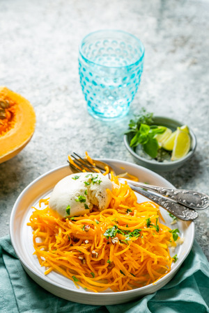 Butternut squash noodles with mozzarela, pecans, herbs