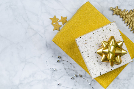 Christmas concept - silver and gold presents with confetti anf ribbon Stock Photo
