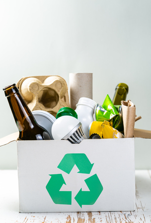 Recycling concept - recyclable materials in box