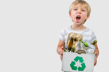 Boy holds box with recyclable materials Stock Photo