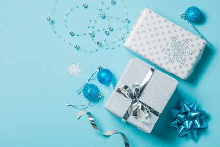 Christmas background - presents and decorations in silver and blue