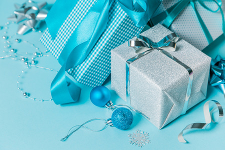 Christmas background - presents and decorations in silver and blue, copy space