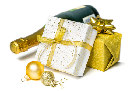 Christmas concept - silver and gold presents with champagne and balls Stock Photo - 112360341