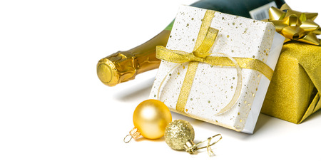 Christmas concept - silver and gold presents with champagne and balls Stock Photo - 112360348