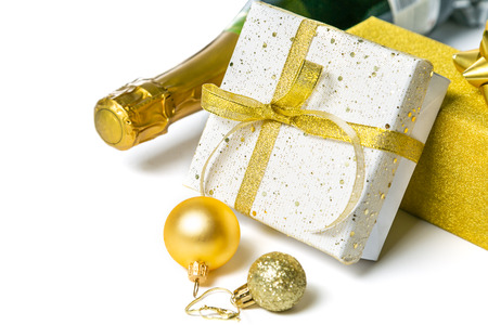 Christmas concept - silver and gold presents with champagne and balls