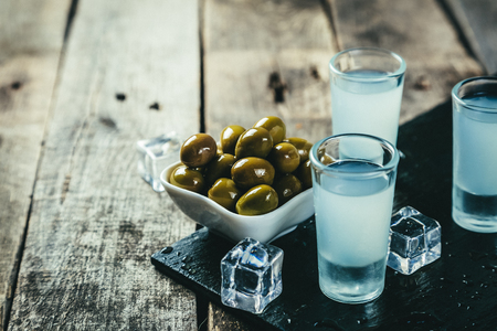 Traditional greek vodka - ouzo in shot glasses 스톡 콘텐츠