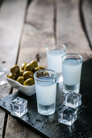 Traditional greek vodka - ouzo in shot glasses Stock Photo